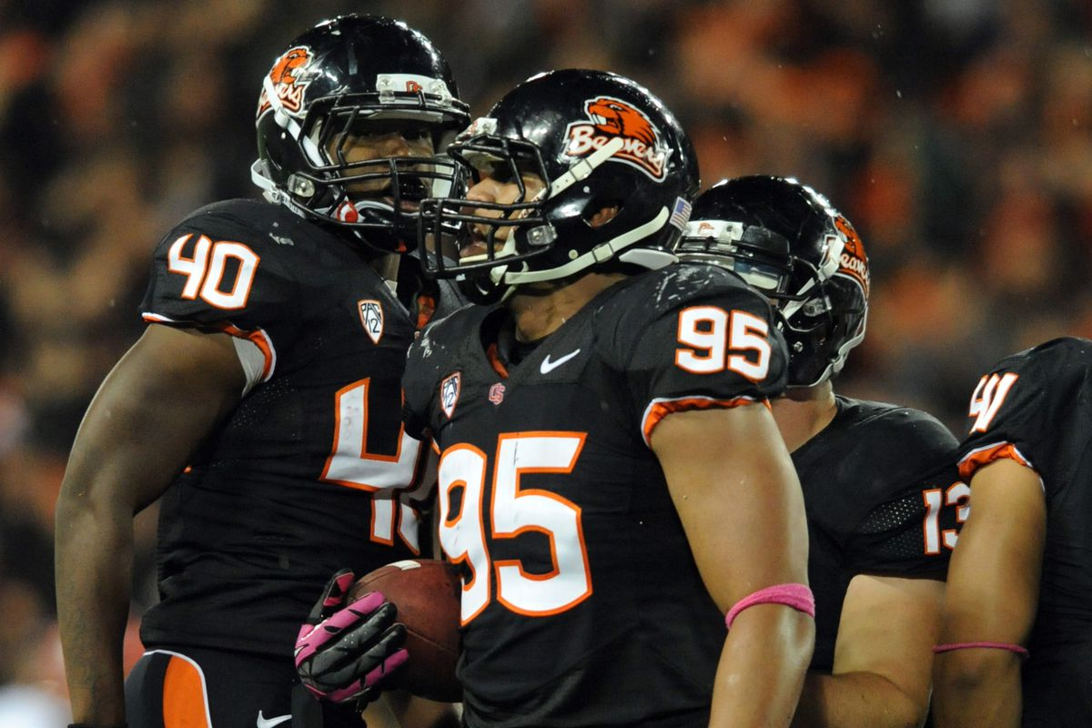 CORVALLIS, OR - OCTOBER 20: Defensive end Scott Crichton #95 of the Oregon State Beavers celebrates after recovering a fumble in the third quarter of the game against the Utah Utes on October 20, 2012 at Reser Stadium in Corvallis, Oregon.