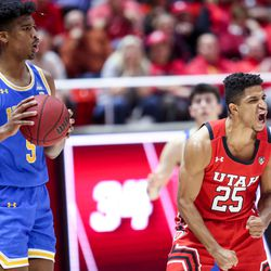 UCLA Bruins guard Chris Smith (5) and Utah Utes guard Alfonso Plummer (25) react to a call at the Jon M. Huntsman Center in Salt Lake City on Thursday, Feb. 20, 2020.