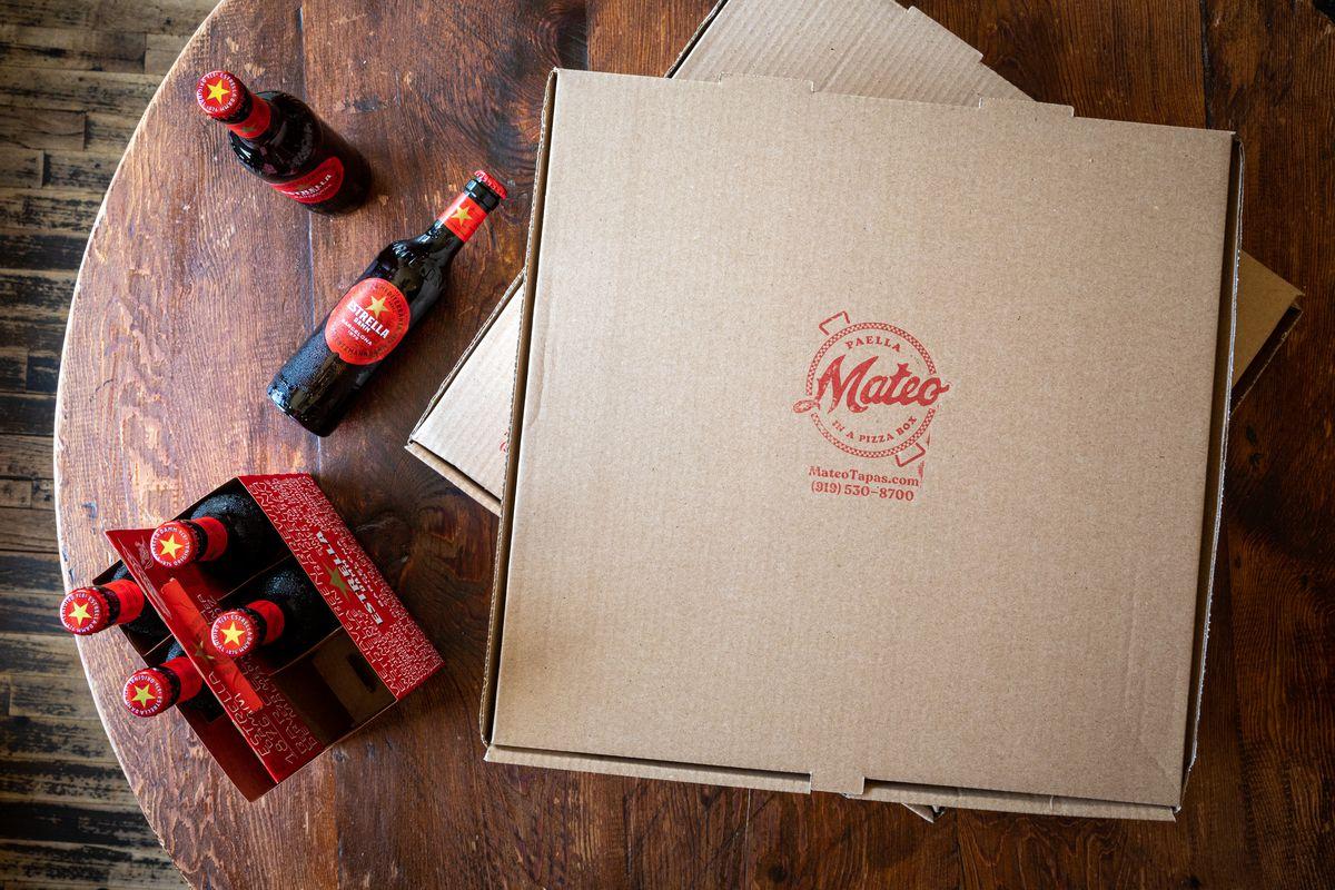 Paella in a pizza box at Mateo