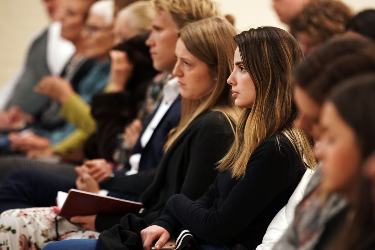 Giulia Rogue listens to President M. Russell Ballard, acting president of the Quorum of the Twelve Apostles of The Church of Jesus Christ of Latter-day Saints during a devotional for young single adults, single adults over 31 and young married couples in New York City on Saturday, Nov. 16, 2019.