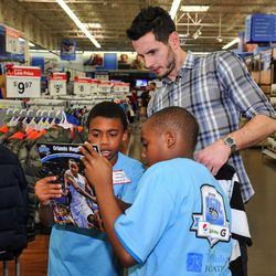 Magic guard J.J. Redick helps youth from the Boys & Girls Clubs shop during the Magic and Pepsi holiday shopping spree event on December 18.