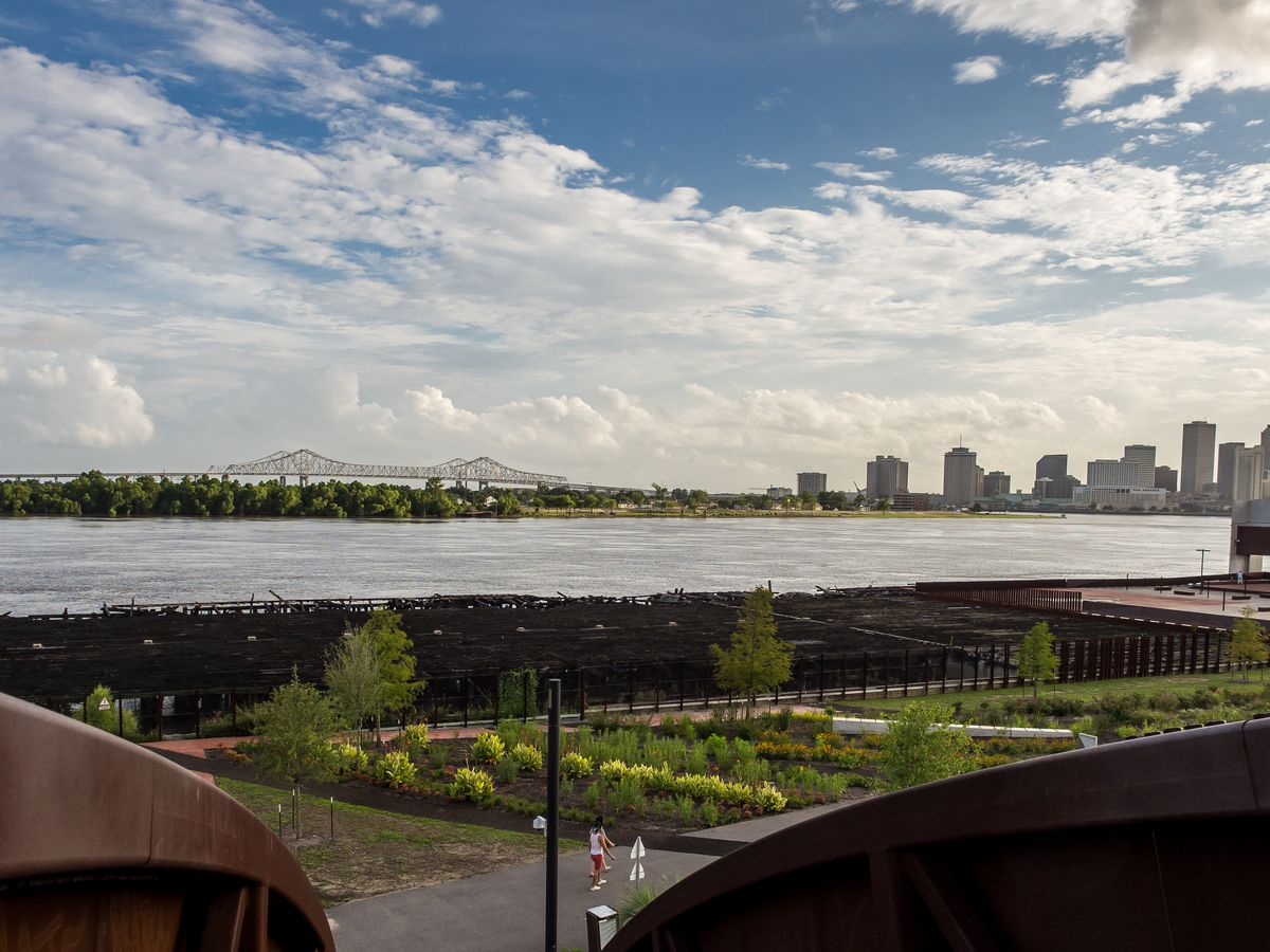 A view from the top of the metal stairs leading to Crescent Park looks at the Mississippi River and New Orleans skyline.
