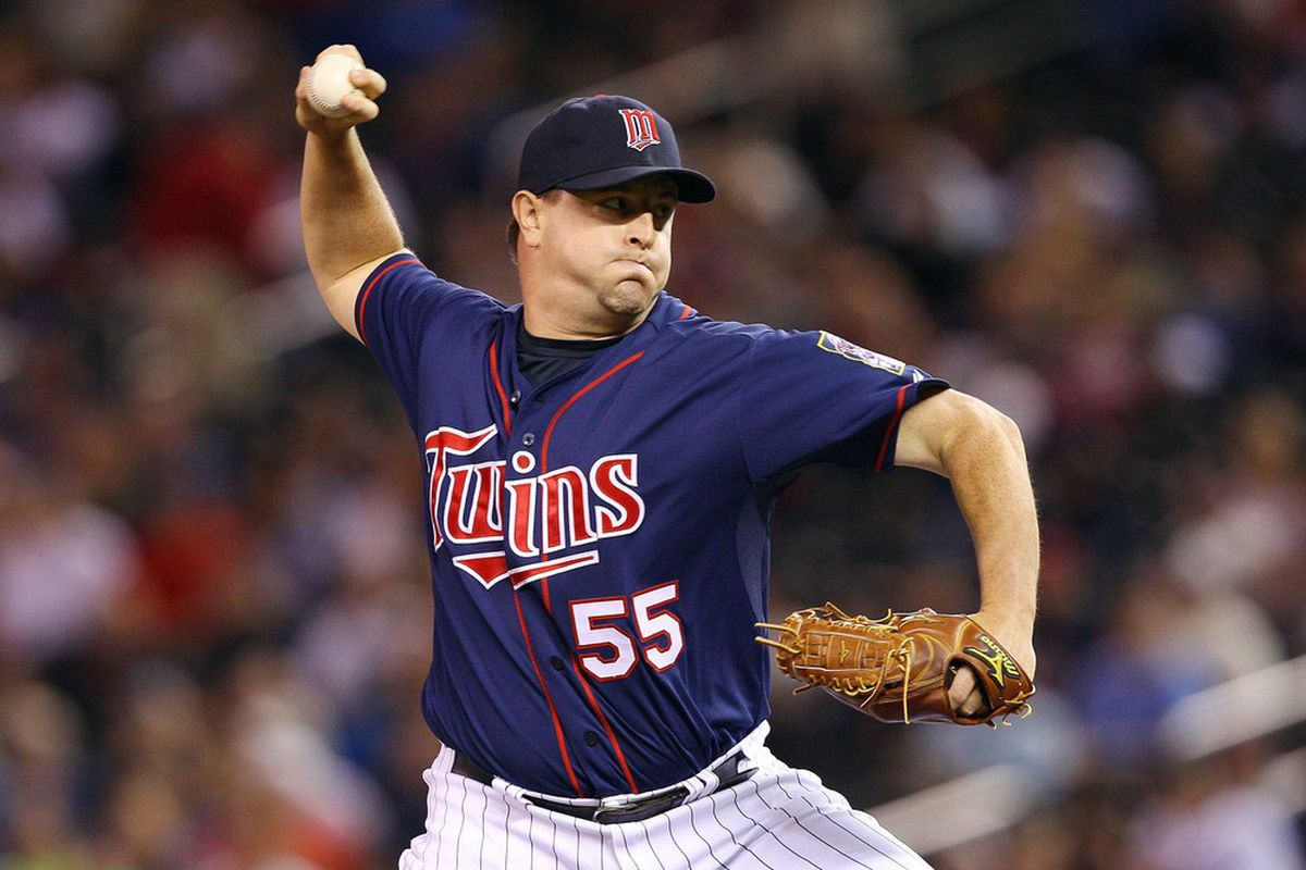 June 12, 2012; Minneapolis, MN, USA: Minnesota Twins relief pitcher Matt Capps (55) delivers a pitch in the ninth inning against the Philadelphia Phillies at Target Field. The Twins won 11-7. Mandatory Credit: Jesse Johnson-US PRESSWIRE