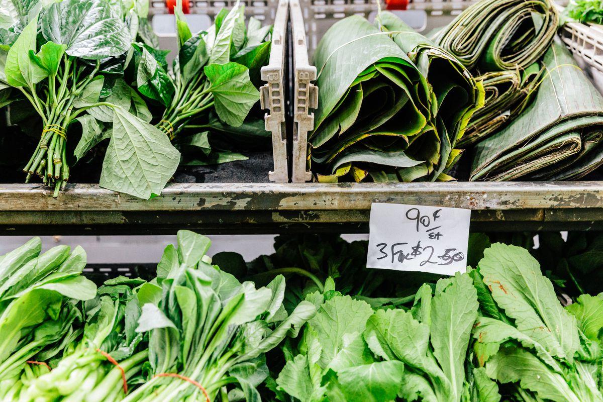 Racks of greens and herbs at Footscray Market