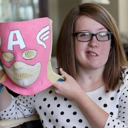 Provo resident Natalie Wright was the first adolescent to complete proton radiation therapy at San Diego at Rady Childrens Hospital at Scripps Proton Therapy Center, to treat her brain tumor, doctors made her a superhero mask to hold her head still Monday, July 21, 2014, in Provo.