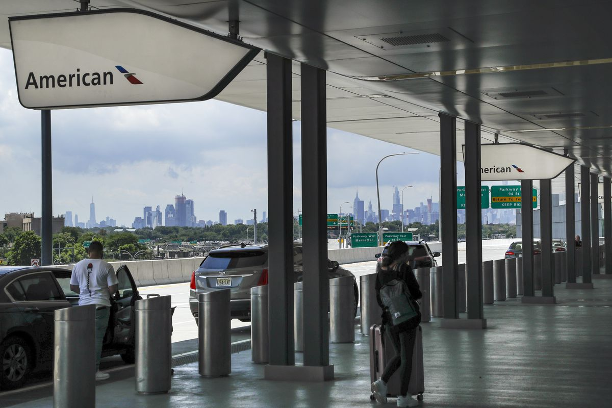In this Wednesday, July 15, 2020, file photo, people arrive at the drop-off area of Terminal B at LaGuardia Airport in New York. Airlines are trying to convince a frightened public that measures like mandatory face masks and hospital-grade air filters make sitting in a plane safer than many other indoor settings during the coronavirus pandemic, but it isn't working.