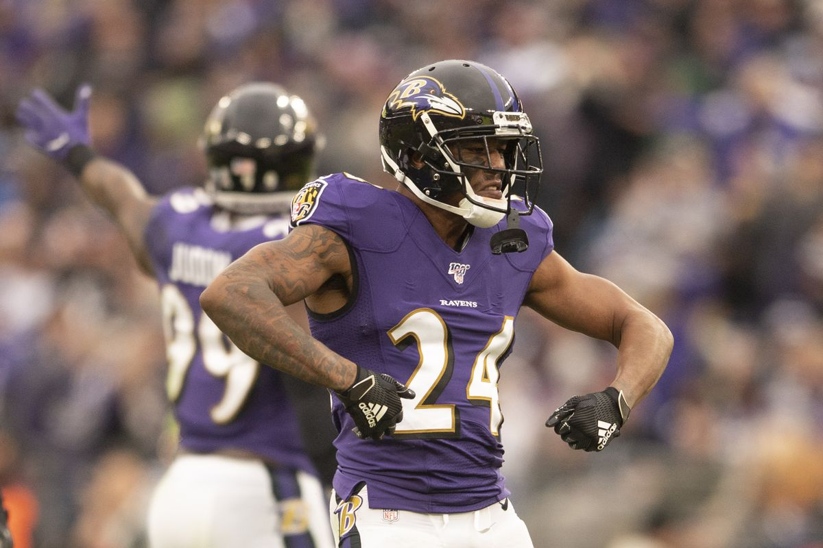 Baltimore Ravens cornerback Marcus Peters (24) reacts after breaking up a pass on fourth down against the Houston Texans at M&T Bank Stadium.