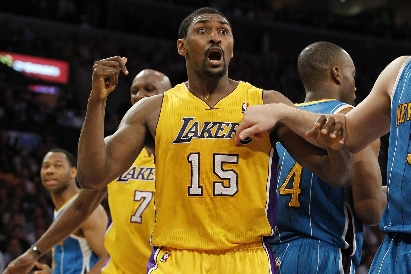 Lakers forward Ron Artest vehemently disagrees with a referee's call as the ball is awarded to the