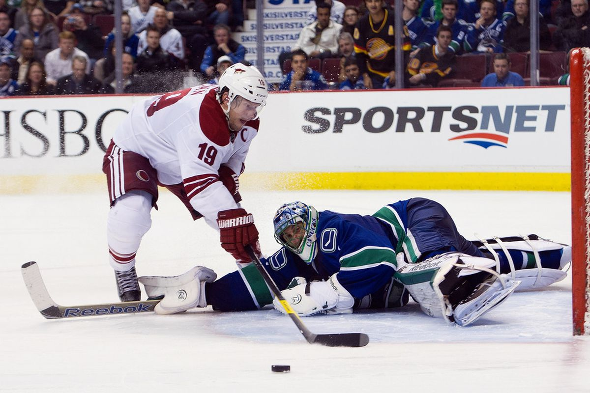 Goalie Roberto Luongo #1 of the Vancouver Canucks stops Shane Doan #19 of the Phoenix Coyotes during the shootout in NHL action on February 13, 2012 at Rogers Arena in Vancouver, British Columbia, Canada.  (Photo by Rich Lam/Getty Images)