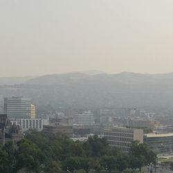 Smoky air hangs over Salt Lake City on Friday, Aug. 6, 2021.