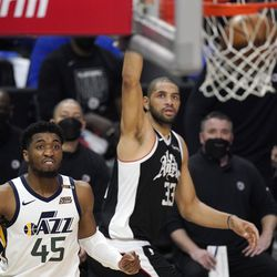 Los Angeles Clippers forward Nicolas Batum, right, scores as Utah Jazz guard Donovan Mitchell watches during the second half in Game 6 of a second-round NBA basketball playoff series Friday, June 18, 2021, in Los Angeles.