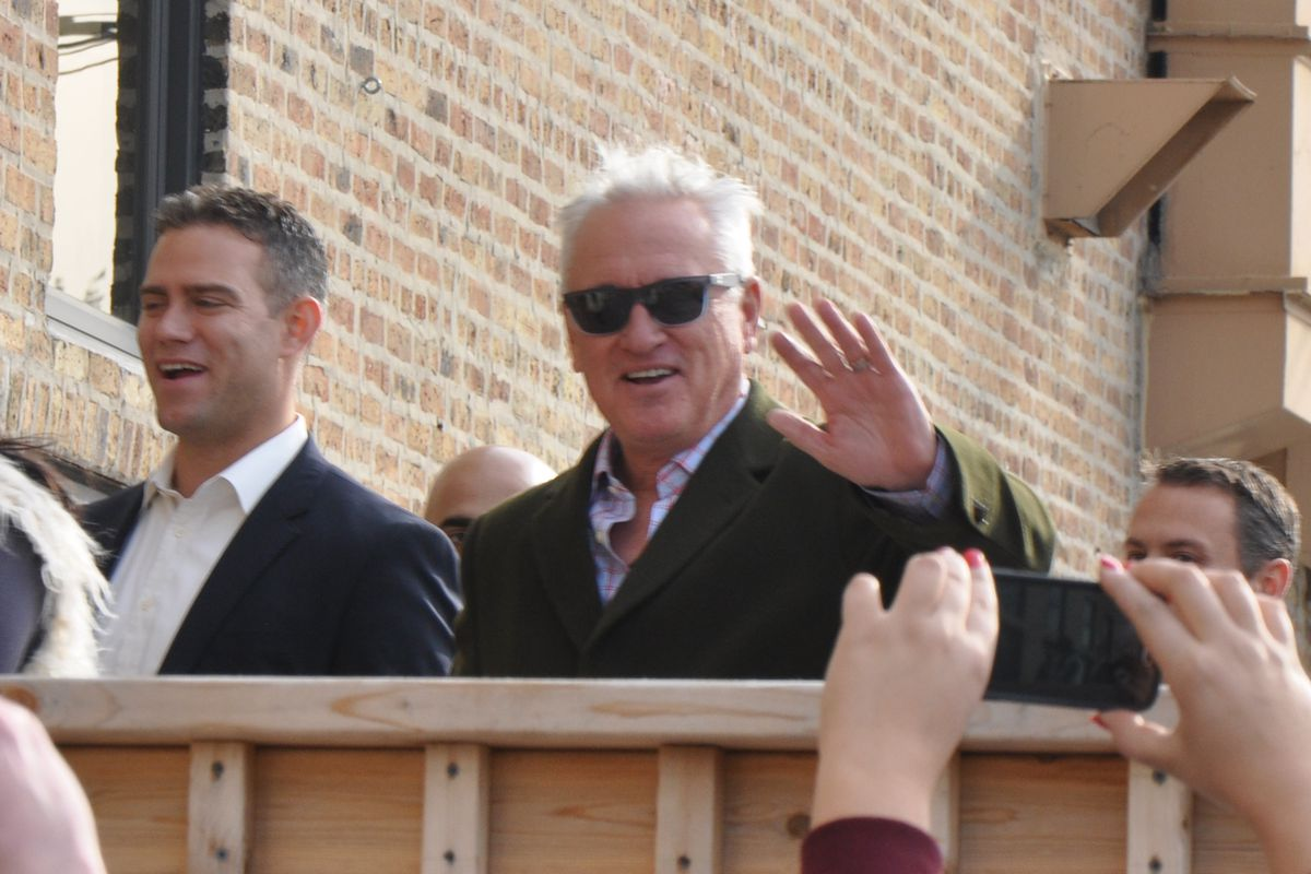Joe Maddon (with Theo Epstein) about to enter his introductory news conference last November