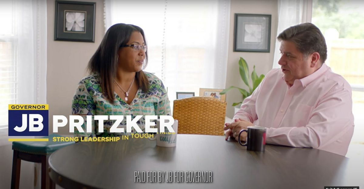 Gov. J.B. Pritzker talks with registered nurse Jenica Krushall in a campaign commercial released Friday.