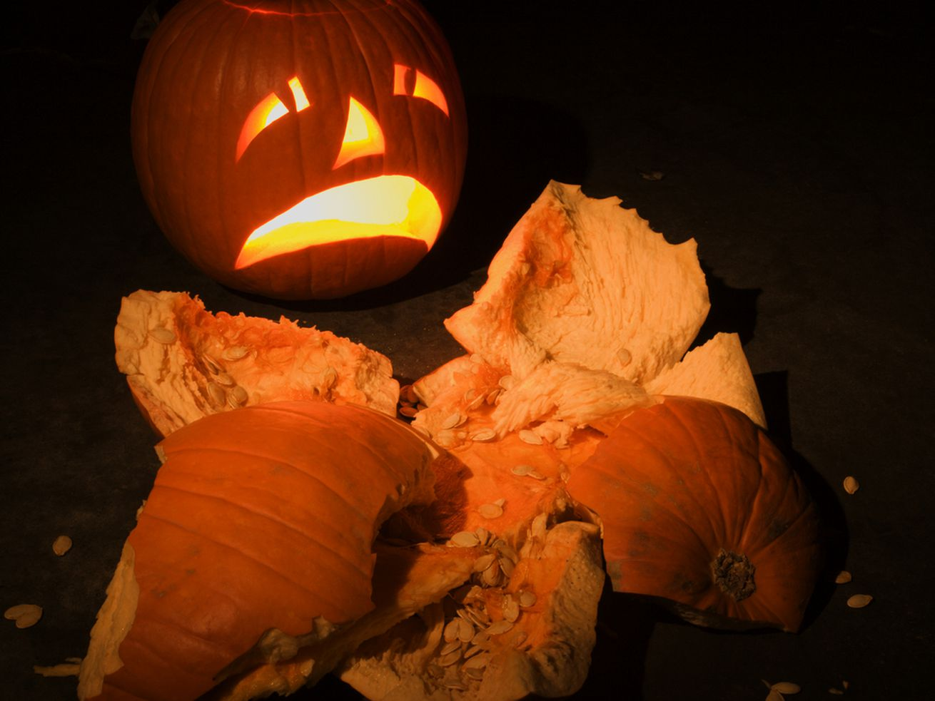 A jack o lantern cries at the sight of a smashed pumpking