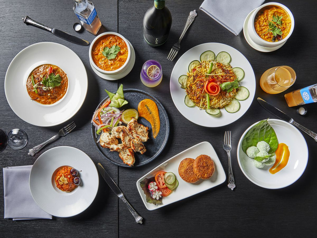 A variety of Indian dishes spread out on a table.