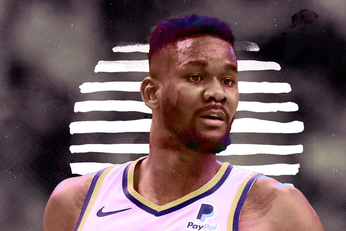 A zoomed in shot of Deandre Ayton's face on the court.