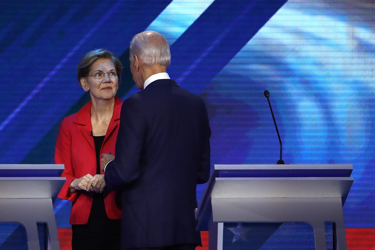 Democratic presidential candidates Senator Elizabeth Warren and former Vice President Joe Biden speak during a break in the Democratic Presidential Debate at Texas Southern University's Health and PE Center on September 12, 2019, in Houston, Texas.