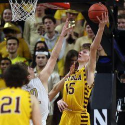Loyola's Bennett Kwiecinski (15) scores over St. Ignatius's Derek Dingens (22) at Northwestern University in Evanston, Friday, February 8, 2019.   Kevin Tanaka/For the Sun Times