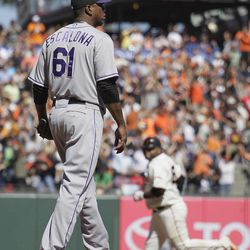 San Francisco Giants' Pablo Sandoval, right, circles the bases after hitting a three-run homer off Colorado Rockies relief pitcher Edgmer Escalona, left, during the fourth inning of their baseball game in San Francisco, Thursday, Sept. 20, 2012.