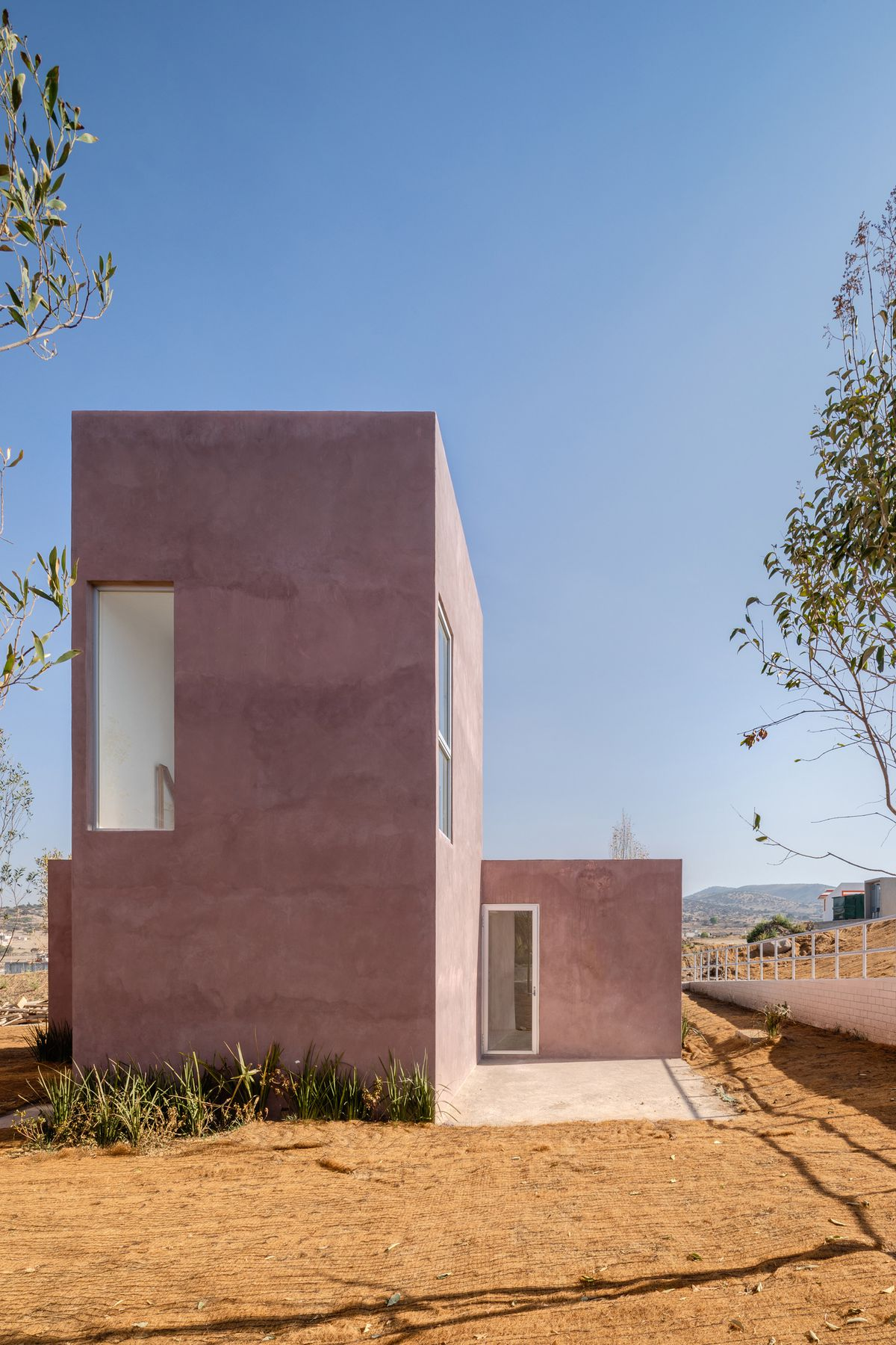 Two dusty pink blocky volumes forming a house.