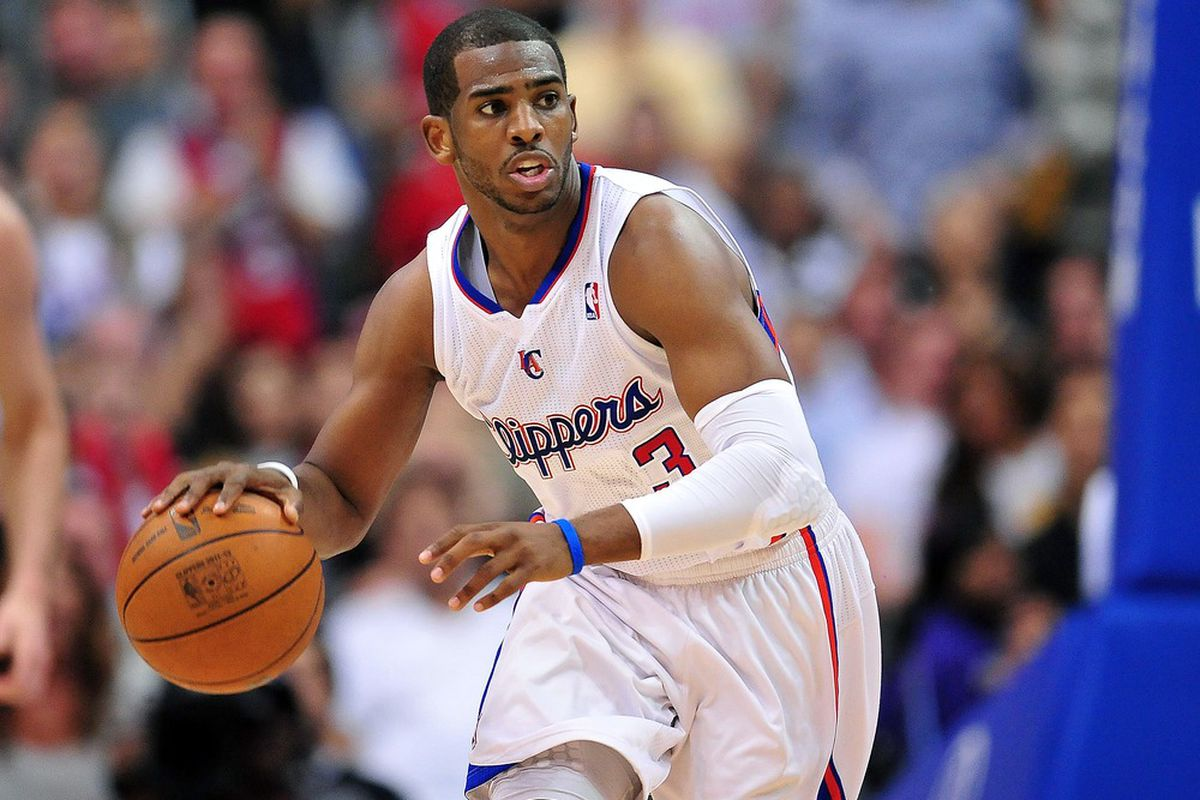 April 4, 2012; Los Angeles, CA, USA; Los Angeles Clippers point guard Chris Paul (3) moves the ball up court against the Los Angeles Lakers during the second half at Staples Center. Mandatory Credit: Gary A. Vasquez-US PRESSWIRE