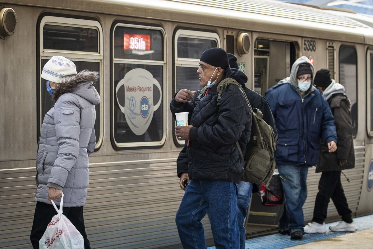 Passengers board a Red Line train on the North Side.