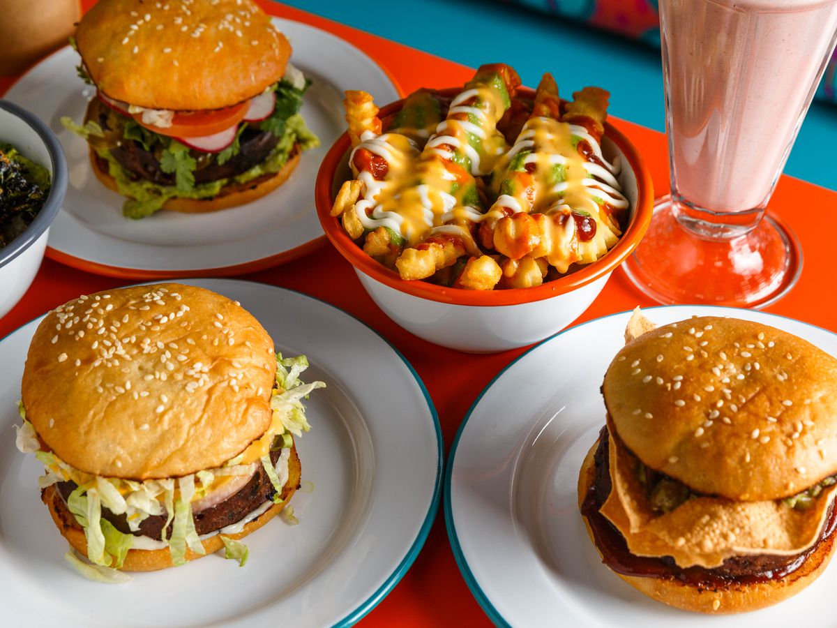 """Assorted burgers, """"messy fries,"""" and an oat milk strawberry shake at Lekka Burger."""