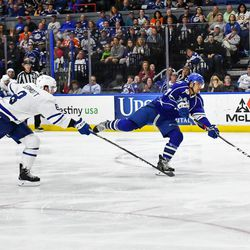 Syracuse Crunch Mathieu Joseph (7) fires the puck aas Toronto Marlies Travis Dermott (8) gives chase in American Hockey League (AHL) Calder Cup Playoff action at the War Memorial Arena in Syracuse, New York on Sunday, May 6, 2018. Toronto won 7-1.