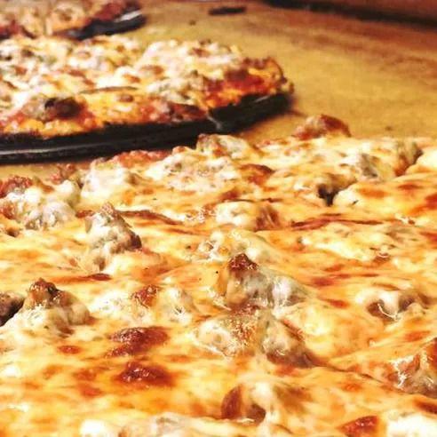 Several thin crust pizzas.