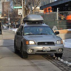 Car on the Waveland sidewalk at Kenmore -