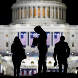 Ellen Emanuel, Lynae Lytle and Spencer Landis, of Lincoln, Neb., walk around and take photos outside the U.S. Capitol in Washington, D.C., on Thursday, Jan. 19, 2017. The trio came to visit a friend and see the nation's capital for the first time.
