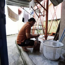 Caesar C. Rosales does laundry in Cebu, Saturday, Nov. 23, 2013. The Rosales family was displaced from Tacloban to the home of a friend following a typhoon.