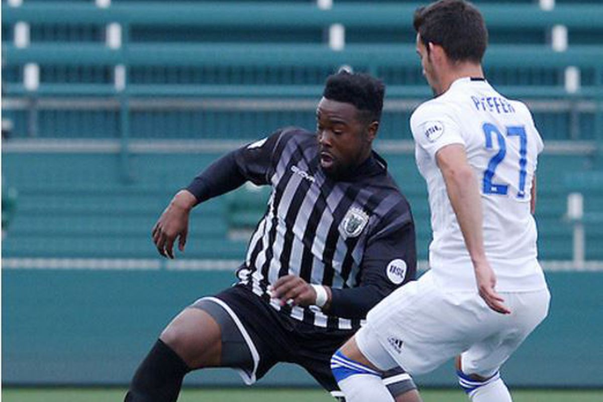 Dominic Samuel moves past Zach Pfeffer of Charlotte Independence when the teams finished scoreless on May 14.