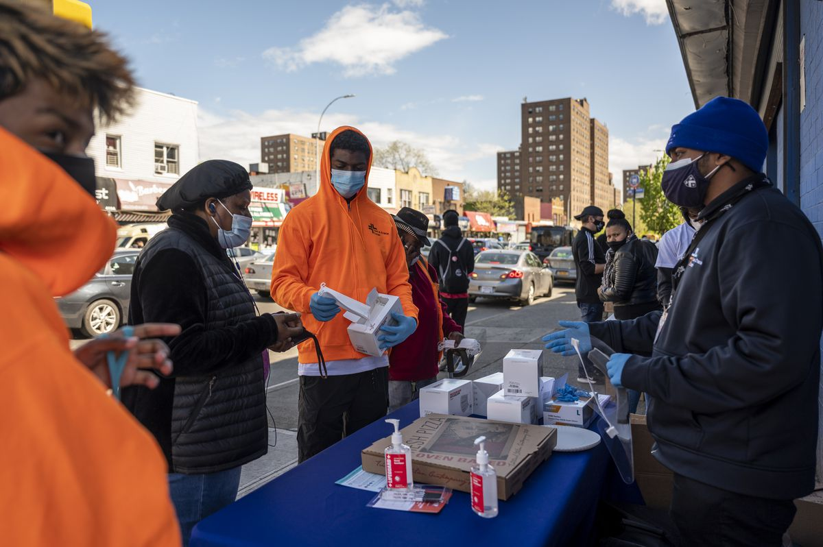 NYC Health + Hospitals workers distribute personal protection equipment and make COVID-19 vaccination appointments on Mother Gaston Boulevard in Brownsville. Friday, Apr. 30, 2021