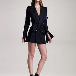 "<b>Maison Martin Margiela</b> Peak-Lapel jacket dress, <a href=""http://www.neimanmarcus.com/product.jsp?itemId=prod145480141&ecid=NMALRJ84DHJLQkR4&CS_003=5630585"">$2,240</a>."