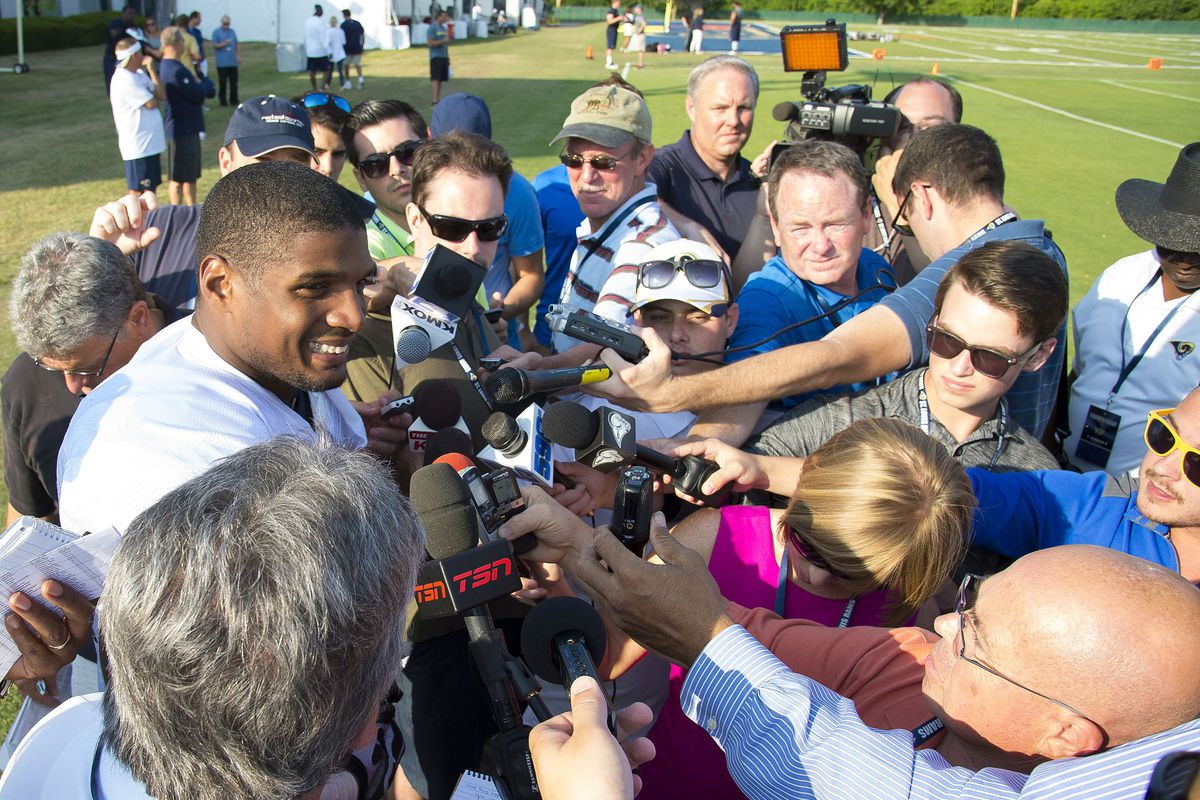 Michael Sam surrounded by media during Rams training camp.
