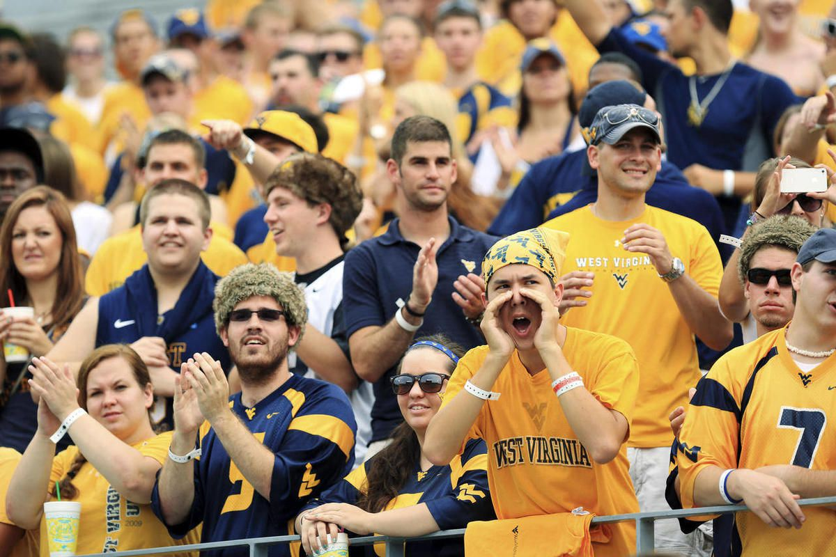 West Virginia students cheer during their NCAA college football game against Marshall in Morgantown, W.Va., Saturday, Sept. 1, 2012. West Virginia won 69-34.