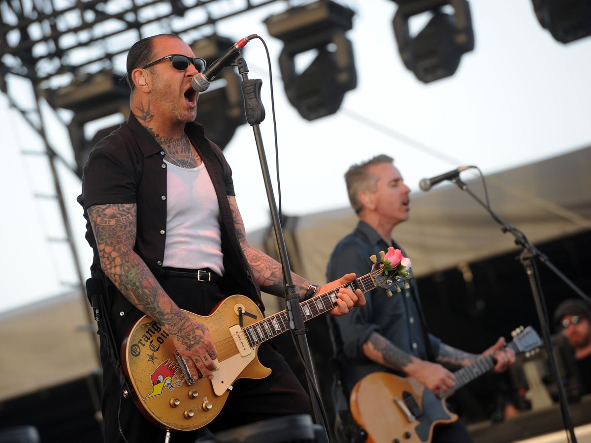 Mike Ness (L) and Jonny '2 Bags' Wickersham of the band Social Distortion performs at Coachella i 2013. The band is among the lineup for the 2016 Riot Fest Chicago. |Photo by Kevin Winter/Getty Images for Coachella