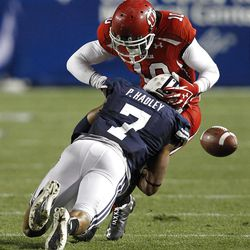 Utah Utes wide receiver DeVonte Christopher (10) is hit so hard he had to leave the game by Brigham Young Cougars defensive back Preston Hadley (7)as the University of Utah and Brigham Young University play football Saturday, Sept. 17, 2011, in Provo, Utah.