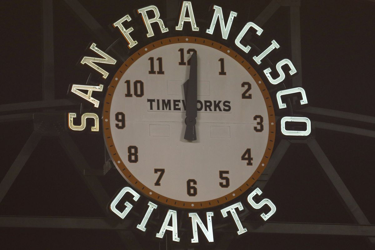 The clock passes midnight in the twelfth inning of the San Francisco Giants game against the Los Angeles Dodgers at AT&T Park in San Francisco, Calif. early Wednesday morning, April 16, 2014.