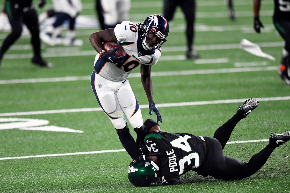 New York Jets cornerback Brian Poole (34) tackles Denver Broncos wide receiver Jerry Jeudy (10) in the second half.