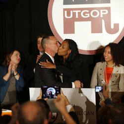 Mia Love, 4th Congressional District Republican candidate, gets a kiss from her husband, Jason, as she declares victory on election night in Salt Lake City, Tuesday, Nov. 4, 2014.