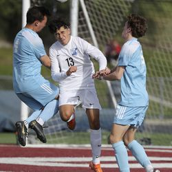 Sky View's Kai Schwartz, Stansbury's Larry Ramirez and Sky View's Landon McClellan go for the ball during the 4A boys soccer semifinals at Jordan High School in Sandy on Monday, May 17, 2021. Stansbury won in a shoot-out after double overtime.