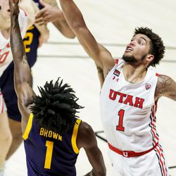 Utah Utes forward Timmy Allen (1) defends as California Golden Bears guard Joel Brown (1) goes to the hoop during the game at the Huntsman Center in Salt Lake City on Saturday, Jan. 16, 2021.