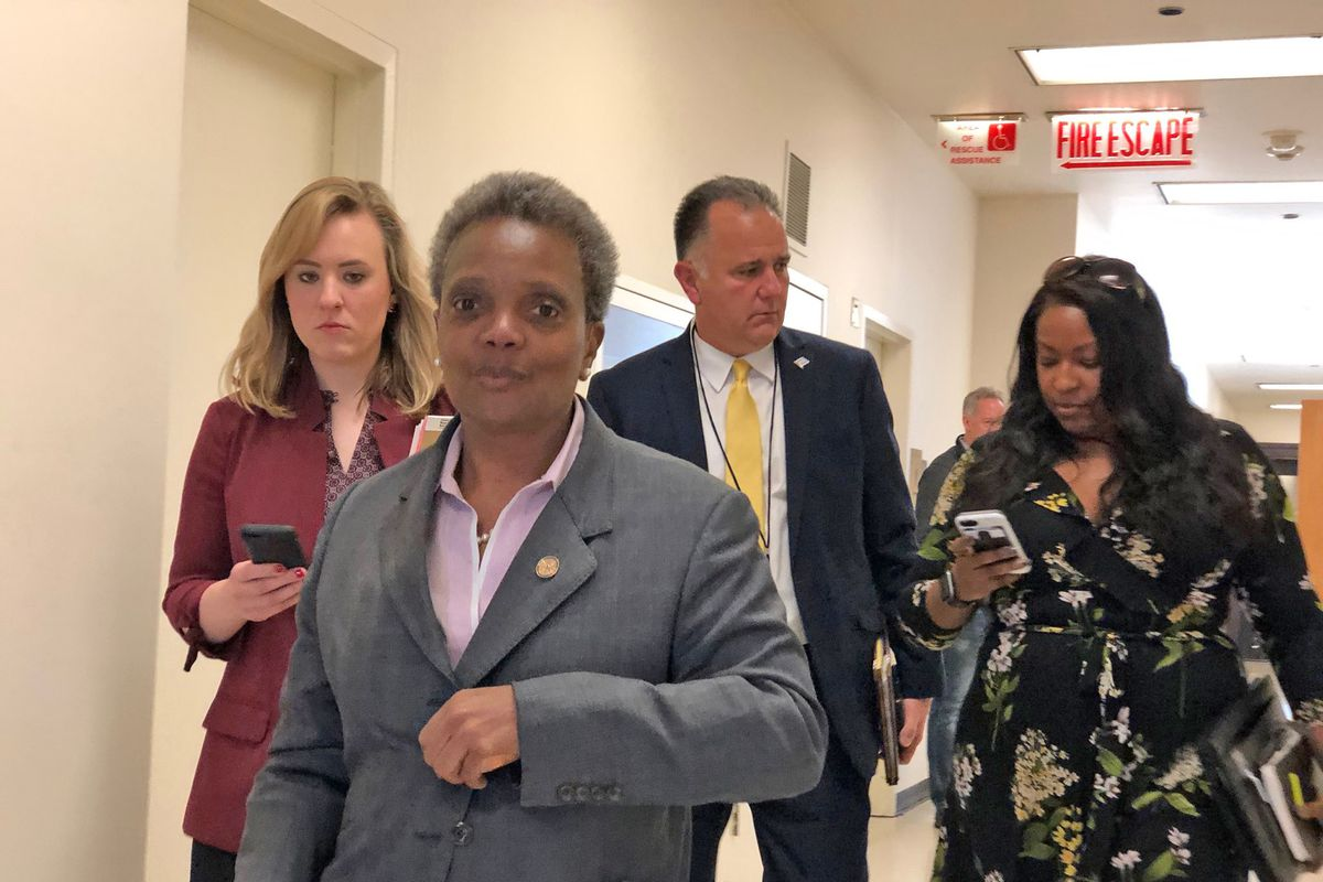 Lori Lightfoot with James Smith, head of security detail