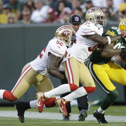 San Francisco 49ers' Patrick Willis (52) and  Donte Whitner (31) try to stop Green Bay Packers' Jermichael Finley (88) after a catch during the second half of an NFL football game Sunday, Sept. 9, 2012, in Green Bay, Wis. The 49ers won 30-22.