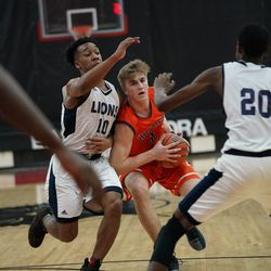 Naperville North's Tom Welch (1) tries to get past Lincoln Park's Tahir Thompson (10), Saturday 02-02-19. Worsom Robinson/For the Sun-Times.