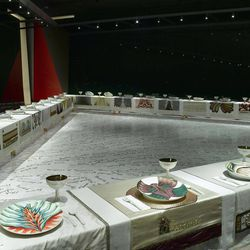 """In this undated photo provided by the Brooklyn Museum in New York, an art installation entitled """"The Dinner Party,"""" by Judy Chicago, is seen in the Brooklyn Museum's Elizabeth A. Sackler Center for Feminist Art in New York. The work is a massive triangular banquet table elaborately set for 39 historical female figures, 13 from each millennium, plus 999 other female names are inscribed in gold in the tiled floor. The Brooklyn Museum's feminist art center is marking its fifth anniversary this year by commemorating famous women of the next millennium."""