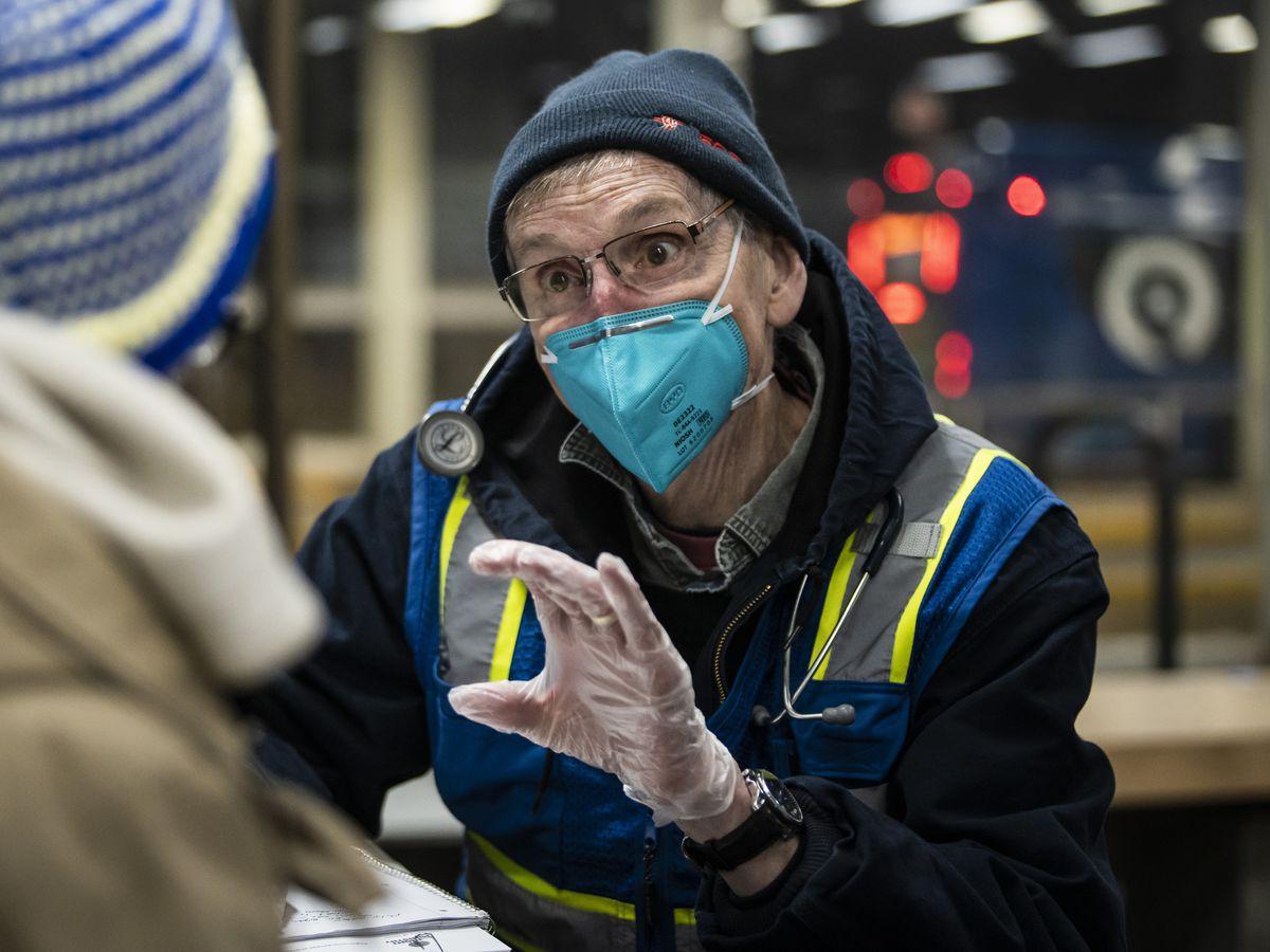 Dr. Ralph Ryan, 69, a retired cardiologist who lives in Elmhurst, volunteers with the Night Ministry and provides free health care at the CTA's Blue Line Forest Park station, Wednesday night, Feb. 23, 2021. | Ashlee Rezin Garcia/Sun-Times