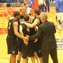 SLCC's Tyler Rawson and Gibson Johnson huddle with teammates during timeout.